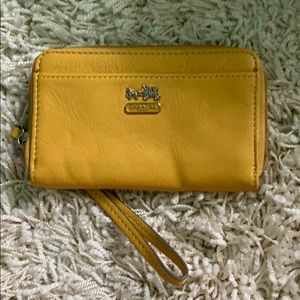 NWOT Coach yellow wristlet